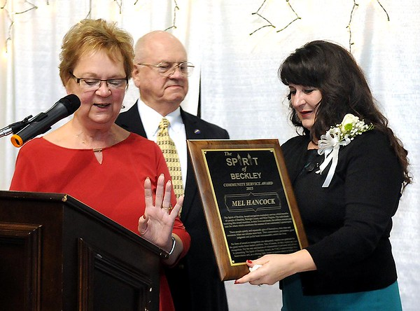 Judy Lilly Harrah and Tom Lilly, present the The Spirit of Beckley award to Mel Hancock's wife Tammy Hancock.