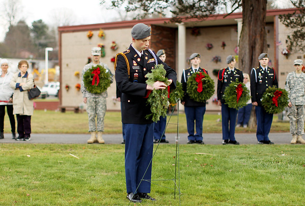 Fayette Institute of Technology Army JROTC cadet Aidan Mitchell, from Oak Hill, salutes a wreath he hung in remembrance of those that served in the Army during a ceremony as part of the national Wreaths Across America ceremony. Seven ceremonial wreaths were placed to remember those who served, honor their sacrifices, and teach our younger generations about the high cost of our freedoms.