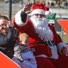 Brad Davis/The Register-Herald<br /> Santa Claus waves to the masses as he rolls along Neville Street during Beckley's annual Christmas Parade Saturday afternoon.