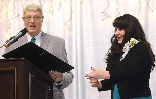 """Beckly mayor Bill O'Brien presents the Governor's Certificate of Recognition to Mel Hancock's wife, Tammy Hancock during the """"Spirit of Beckley"""" awards fundraiser dinner."""