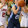 Brad Davis/The Register-Herald<br /> Meadow Bridge's Sheyla Harless drives to the basket as Liberty's Morgan Stover, left, tries to stop her Friday night in Glen Daniel.