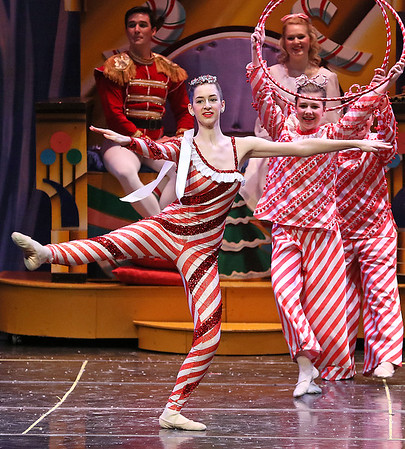 """Brad Davis/The Register-Herald<br /> The Czarina (nearest), played by Emily Cernuto, dances during the """"Russian Cany Canes"""" portion of Beckley Dance Theatre's The Nutcracker Sunday afternoon inside the Woodrow Wilson High School Auditorium."""