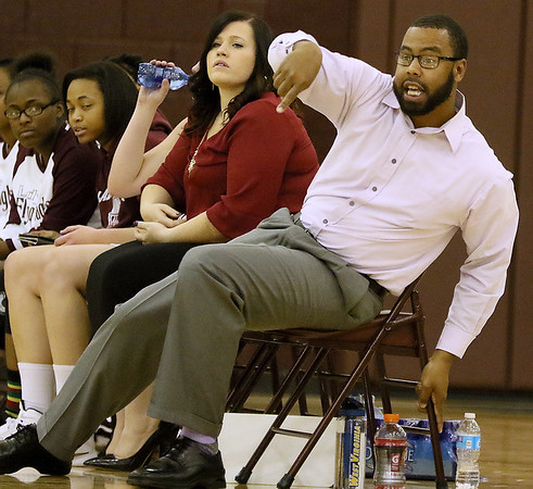 Brad Davis/The Register-Herald<br /> Woodrow Wilson assistant coach Gene Nabors instructs his team from the bench during a home game against Oak Hill December 2.