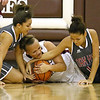 Brad Davis/The Register-Herald<br /> Woodrow Wilson's Baylee Brooks battles for a loose ball with Oak Hill's Taea Scruggs, left, and Ashley McDowell during the Lady Eagles' win over the Red Devils Wednesday night in Beckley.