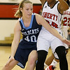 Brad Davis/The Register-Herald<br /> Meadow Bridge's Micah Farr drives to the basket as Liberty's Lydia Philogene defends Friday night in Glen Daniel.