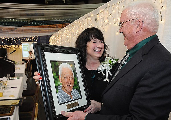 Rob Rappold, right, shares some memories with Tammy Hamcock, wife of the late Mel Hancock, after the Spirit of Beckley awards fundraiser dinner.