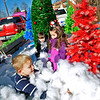"Brad Davis/The Register-Herald<br /> Six-year-old Tucker Harvey (nearest), three-year-old Connor Winston (middle) and five-year-old Abby Billups serve as quality control and make sure all the fluffy white fake snow is in place and ready - by burying each other in it - on Suddenlink's ""Welcome to Oddville"" float prior to Saturday's annual Christmas Parade."