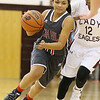 Brad Davis/The Register-Herald<br /> Oak Hill's Taea Scruggs drives up the court as Woodrow Wilson's Shytiece McDowell, right, defends during the Lady Eagles' win over the Red Devils Wednesday night in Beckley.