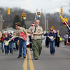 Local scouts lead the procession during Sophia's annual Christmas parade on Saturday. There were around 20 different entrees into the parade.