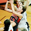 Summers County's Hannah Taylor (13) attempts a layup over Chapmanville's Abby Marcum (20) during the championship game of Rogers Oil Classic at Summers County High School in Hinton on Saturday.