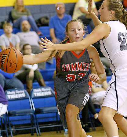 Brad Davis/The Register-Herald<br /> Summers County's Brittney Justice reaches out to pass the ball to an open teammate as Shady Spring's Morgan Brown defends during the Lady Bobcats' win over the Tigers Thursday night in Shady Spring.