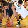 Brad Davis/The Register-Herald<br /> Westside's James Colucci and Wyoming East's Michael Hayworth battle for a loose ball Friday night in New Richmond.
