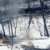 Chris Jackson/The Register-Herald<br /> Crude oil burns on the Kanawha River where a train derailed on its way to Lynchburg, Va., near Montgomery, W.Va., on Tuesday, February 17, 2015.