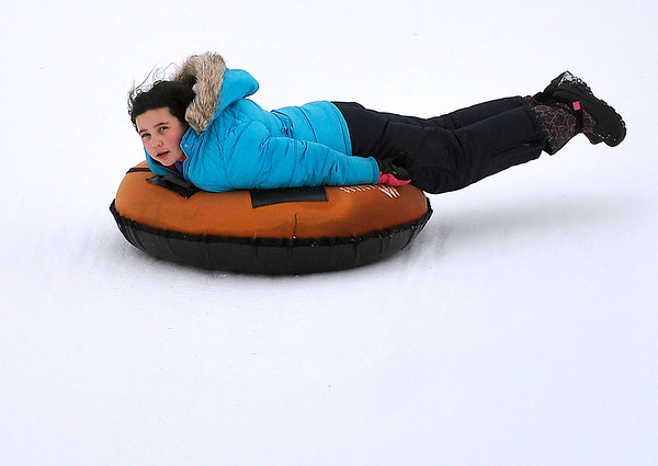 Brad Davis/The Register-Herald<br /> Nine-year-old Fiona McHenry speeds down the track head first at Winterplace Ski Resort's snowtubing park Sunday afternoon. The Vincent, Ohio resident and girl scout was visiting the Ghent resort with her family and fellow scouts from Troop 1226 for the Black Diamond Council's Family Frolic event, which brought Girl Scout troops from all over the region out to the slopes.
