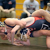 Brad Davis/The Register-Herald<br /> Greenbrier West's Dustin Yoakum battles with Independence's Adam Daniels in a 138-pound weight class matchup during the Coalfield Invitational Saturday evening in Fairlea. Yoakum would win the match.