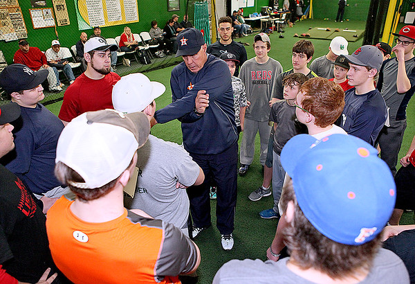 Brad Davis/The Register-Herald<br /> Houston Astros pitching coach Brent Strom, upper middle, advises young baseball players from all over the area during a clinic at the Upper Deck Baseball & Softball Academy Saturday afternoon. Strom was in town again this year to help the Beckley area's high school, youth and little league stars of tomorrow hone their craft with major league knowledge and coaching.