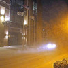 Brad Davis/The Register-Herald<br /> The headlights of what can barely be made out as a small car do their best to pierce through nighttime whiteout conditions Saturday night as another gust of wind whips through Main Street in downtown Beckley. The area was ambushed by an evening snowstorm that made road and driving conditions a dangerous proposition for anyone who braved them.