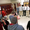 Brad Davis/The Register-Herald<br /> Woodrow Wilson athletes (from left) Brandon Hansford, Noah Hancock, Troy Lilly and Josh Creed pose for photos with their head football coach John Lilly following their national signing day ceremony February 4th. Hansford will attend Fairmont State, Hancock is headed for Concord, Creed is bound for Alderson Broaddus and Lilly is one of two West Virginia University signees from in-state.