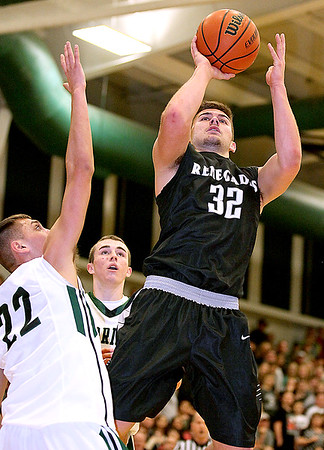 Brad Davis/The Register-Herald<br /> Westside's Justin Cogar drives to the basket and scores as Warriors forward John Morgan, far left, defends during the Renegades' win over cross-county rival Wyoming East Friday night in New Richmond.