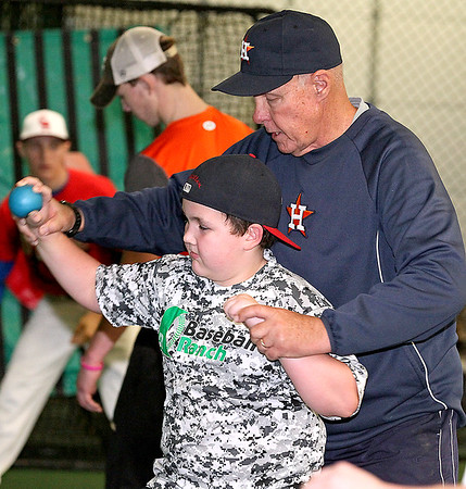 Brad Davis/The Register-Herald<br /> Ten-year-old Madison resident Griffin Miller gets some professional help with his throwing mechanics from Houston Astros pitching coach Brent Strom Saturday afternoon at the Upper Deck Baseball & Softball Academy. Miller, a third baseman for the Pirates of Madison Little League, was one of several young baseball players at levels ranging from high school to little league attending Upper Deck's clinic for some major league-caliber training.