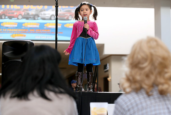 """Brad Davis/The Register-Herald<br /> Crossroads Mall patrons watch Saturday morning five-year-old Teyla Browning sing """"The Star Spangled Banner"""" as she auditions to sing the national anthem at beginning of one of Theatre West Virginia's productions later this Summer. Browning was one of several people of all ages trying to secure one of 37 spots the company is trying to fill for anthem singers prior to every show at Grandview Park's Cliffside Amphitheater."""