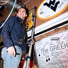 Brad Davis/The Register-Herald<br /> Woodrow Wilson athlete Brent Osborne looks towards friends and family after signing a WVU sign Wednesday evening at Calacino's after making his decision to play football for the Mountaineers, the third player from the Southern area of the state to commit to West Virginia University along with Flying Eagles teammate Troy Lilly and Westside's Justin Cogar.