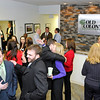 Brad Davis/The Register-Herald<br /> Local business owners, executives and friends from around the area mingle inside Old Colony Realtors on Virginia Street in Beckley Thursday evening during the Beckley-Raleigh County Chamber of Commerce's Business After Hours event.