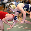 Brad Davis/The Register-Herald<br /> Greenbrier West's Logan Robertson battles with Independence's Hunter Taylor in a 120-pound weight class matchup during the Coalfield Invitational Saturday evening in Fairlea. Robertson would win the match.
