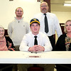 Brad Davis/The Register-Herald<br /> Woodrow Wilson's Troy Lilly poses for a quick photo surrounded by his mother Linda (right), grandmother Patty Meadows (left), head coach John Lilly and assistant coach Max Lilly after signing his letter of intent to play football at West Virginia University during his national signing day ceremony Wednesday afternoon in Beckley.