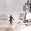 "Brad Davis/The Register-Herald<br /> A pedestrian soldiers through another burst of strong wind and snow as she makes her way up Neville Street towards the Raleigh County Courthouse in more whiteout conditions Wednesday afternoon in Beckley. With sidewalks only cleared off in a few places, the best footing was often in the road, meaning drivers had to take extra care to keep an eye out for them as their vehicles ""skated"" around the area's slippery roadways."