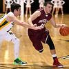 Brad Davis/The Register-Herald<br /> Woodrow Wilson's Brent Osborne drives to the basket Saturday night against Greenbrier East.