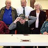Brad Davis/The Register-Herald<br /> Woodrow Wilson's Josh Creed puts on a new hat as he signs his letter of intent to play football at Alderson Brauddus University during his national signing day ceremony Wednesday afternoon in Beckley. Surrounding him are his parents Kim and Dave, along with his grandparents Dorothy and Kenneth Browning and Flying Eagles' head coach John Lilly (background middle).