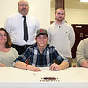 Brad Davis/The Register-Herald<br /> Woodrow Wilson's Brandon Hansford poses for a quick photo surrounded by his parents Robert and Angela, along with head coach John Lilly and assistant coach Max Lilly after signing his letter of intent to play football at Fairmont State University during his national signing day ceremony Wednesday afternoon in Beckley.