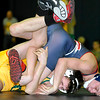 Brad Davis/The Register-Herald<br /> Greenbrier East's Jacob Hefner takes on Independence's Teddy Stover in a 126-pound matchup Saturday afternoon at Shady Spring High School. Stover went on to win the match.