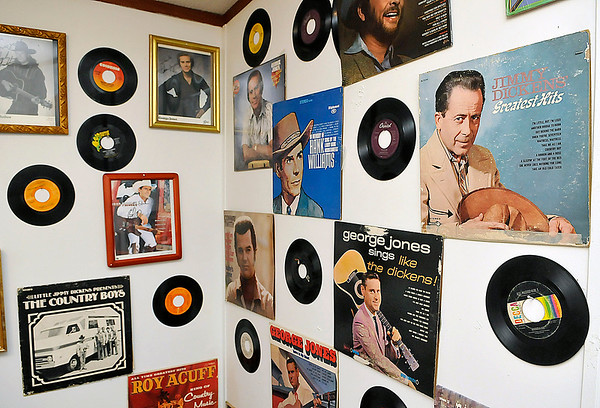 Brad Davis/The Register-Herald<br /> The walls of Dickens' sister Edna Allen's defacto hall of fame are decorated with the albums of country music's biggest stars from the genre's golden age such as Patsy Cline, George Jones, Hank Williams, Merle Haggard and others along with most of Dickens' work. At lower left is one of her rarest Jimmy Dickens albums from when he played with a band called The Country Boys, and at lower right (George Jones Sings Like the Dickens) is an album in which a young George Jones sang Jimmy Dickens songs.