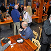 Brad Davis/The Register-Herald<br /> Local business owners, executives and friends from around the area mingle inside Mickey's Mountain Cafe at Winterplace Ski Resort Thursday evening during the Beckley-Raleigh County Chamber of Commerce's Business After Hours event.