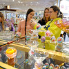 Brad Davis/The Register-Herald<br /> Goldsboro, North Carolina residents (from left) Brianna, Tracey and Nichole Casto do a little shopping at Tamarack Sunday afternoon. Shannon Casto is at far left hidden behind a glass piece. They were visiting with family in the Ripley area over the weekend and decided to stop into Tamarack to check out a few arts and crafts before hitting the road and heading back down South.