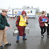 Rick Barbero/The Register-Herald<br /> Residences of Lewisburg get water at the State Fair grounds in Fairlea Monday morning because of a diesel spill in Alvin.