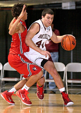 Brad Davis/The Register-Herald<br /> Woodrow Wilson's Brent Osborne drives along the baseline around Washington's Jonathan McFarlin during Big Atlantic Classic action Friday night at the Beckley-Raleigh County Convention Center.