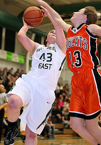 Brad Davis/The Register-Herald Wyoming East's Allie Lusk drives to the basket as Summers County's Hannah Taylor tries to stop her during the Warriors' win over the Lady Bobcats Thursday night in New Richmond.