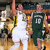 Brad Davis/The Register-Herald<br /> Hampshire's Travis Clower can only watch as Greenbrier East's Tyler Canterbury drives to the basket for two points during Big Atlantic Classic action Friday night at the Beckley-Raleigh County Convention Center.