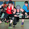 "Brad Davis/The Register-Herald<br /> Greenbrier Roller Vixen and West Virginia All-Star Shawn ""Sha Rollz Bye"" Arnold, left, battles with Beckley Area Derby Dames Jamie ""Madam Mischief"" Tabor, middle, and fellow All-Star Kristy ""Betta WarnHer"" Massie, right, during a combined practice Sunday afternoon at the MacArthur Skating Rink. The Derby Dames have been hosting the West Virginia All-Stars practices every Sunday here in Beckley, and many of their members are on that team along with skaters from other teams in the state such as the Greenbrier Roller Vixens, Morgantown Roller Vixens, Heart of Appalachia Roller Derby and the Chemical Valley Roller Girls. They're preparing for the Battle of the All-Stars States Tournament in Hatfield, Pennsylvania just North of Philadelphia where they'll be one of 10 teams competing for nationwide bragging rights. The tournament runs from February 6th through the 8th and the team will practice with the Derby Dames at MacArthur Skating Rink every Sunday with until then."