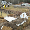 Rick Barbero/The Register-Herald<br /> Crews dammed a creek Monday morning because of a diesel spill in Alvin off of Route 92.