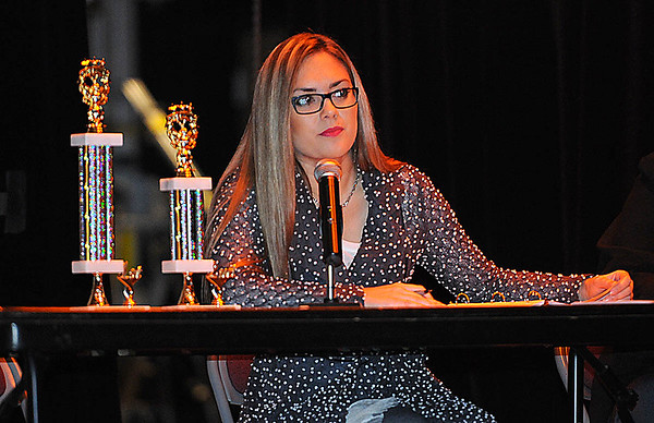 Rick Barbero/The Register-Herald<br /> Hollie Cochran, pronouncer for the Raleigh County Elementary School Spelling Bee Tuesday morning at Woodrow Wilson H.S. auditorium.