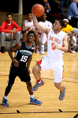 Brad Davis/The Register-Herald<br /> Oak Hill Academy's Lindell Wigginton soars to the basket Wednesday night at the Beckley-Raleigh County Convention Center.