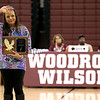 Brad Davis/The Register-Herald<br /> Former Woodrow Wilson Lady Eagles player Kristin Staples waves to the crowd as she's honored during her halftime Hall of Fame induction ceremony Friday night.
