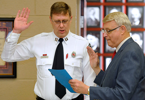 Brad Davis/The Register-Herald<br /> Mayor Bill O'Brien, right, swears in new Beckley Fire Department Chief Ed Wills during a ceremony in the City Council chamber Wednesday afternoon.