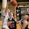 Brad Davis/The Register-Herald<br /> PikeView's Jason Weitzel drives to the basket and scores as Nicholas County's Jacob Grose tries to stop him Saturday night at the Beckley-Raleigh County Convention Center.