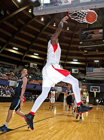 Brad Davis/The Register-Herald<br /> Oak Hill Academy's Dwayne Bacon throws down a dunk off as Combine Academy's Jure Span defends during Big Atlantic Classic action Wednesday night at the Beckley-Raleigh County Convention Center.