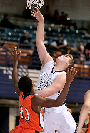 Brad Davis/The Register-Herald<br /> Shady Spring's Tyler Bonds drives to the basket against Martinsburg Friday night.